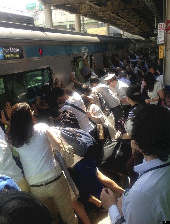 Faith in Humanity: RESTORED! (Desc.). Japanese train passengers tilt a train enough so a woman whose legs were caught between the platform and the train can esc Train faith Awesome