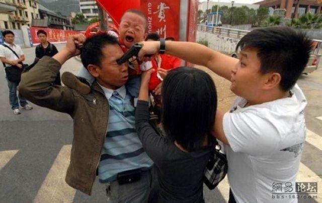 FREEZE MOTHA FOCKA. .. random ass picture for sure gun Asians Crying baby